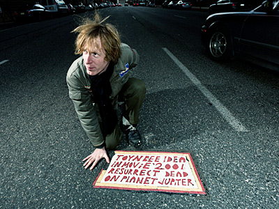 "Justin Duerr with a Toynbee tile in a scene from ""Resurrect Dead: The Mystery of the Toynbee Tiles."" Duerr has been probing the case for years."