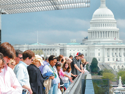 With the Capitol in the background, visitors gather on the terrace of the Newseum, the journalism museum recently moved from Virginia to Washington.