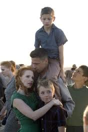 "Jessica Chastain, Brad Pitt and their three movie sons in ""Tree of Life"""