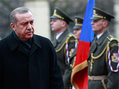 Turkish Prime Minister Recep Tayyip Erdogan reviews the honor guards during a welcoming ceremony at the government&acute;s headquarters in Prague, Czech Republic, Monday, Feb. 4, 2013. (AP Photo/Petr David Josek)<br />