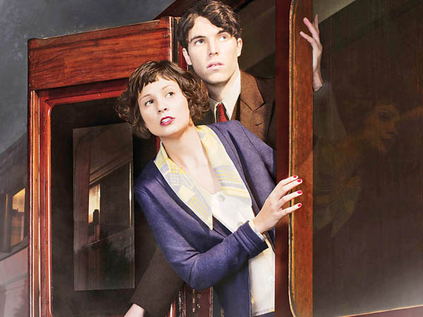 A young socialite suspects foul play when a woman inexplicably disappears from a train, in a stylish and suspenseful new adaptation of the classic thriller The Lady Vanishes. Shown from left to right: Tuppence Middleton as Iris Carr and Tom Hughes as Max (Phil Fisk/BBC for MASTERPIECE)