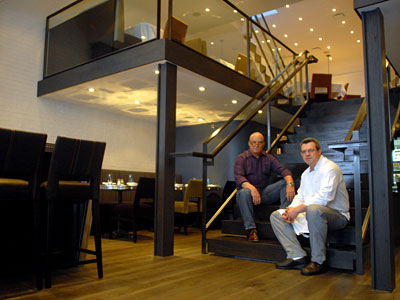 Eddie Bianchini (left) and chef David Cunningham on the stairs at Tweed in May 2010. (Tom Gralish / Staff Photographer )