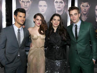 "From left, Taylor Lautner, Kristen Stewart, Stephenie Meyer, and Robert Pattinson attend the world premiere of ""The Twilight Saga: Breaking Dawn Part II"" at the Nokia Theatre on Monday, Nov. 12, 2012, in Los Angeles. (Photo by Matt Sayles/Invision/AP)"