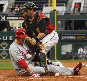 Chase Utley scores a run in the first inning in last night's 6-5 victory over the Pirates.