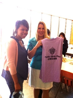 Vanita Young (left) presents a Philly-style chess T-shirt this week to chess master Susan Polgar at the big competition in Lubbock, TX.