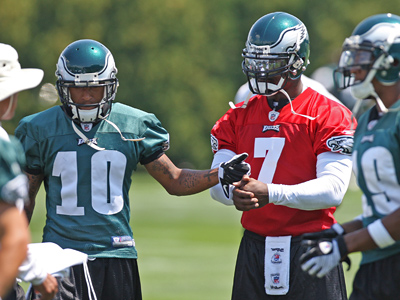 Philadelphia Eagles receiver DeSean Jackson (10) gives an encouraging fist bump to new teammate Michael Vick (7) during Saturday´s practice. (Michael Bryant / Staff Photographer)