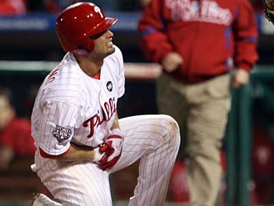 Shane Victorino grimaces after getting hit in the first inning of Game 5. ( Ron Cortes / Staff Photographer )