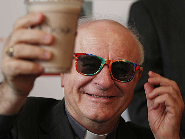 March 2015: Archbishop Vincenzo Paglia, in rainbow sunglasses, holds up the official papal milkshake at Potbelly Sandwich Shop.