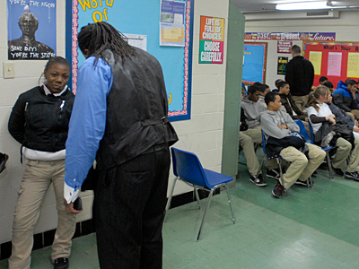Corey Thames, director at Shallcross Academy, singles out a student for inappropriate behavior. At Shallcross, students do not have lockers or backpacks and change classes by walking single file with hands behind their back. (Ron Tarver/Staff)