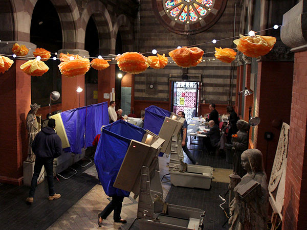 An unidentified voter uses one of the voting machines inside Fleisher Art Memorial on Election Day in Philadelphia on November 4, 2014. Voters of the 17th and 24th Divisions in the 2nd Ward vote at this location. ( DAVID MAIALETTI / Staff Photographer )