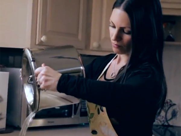 """Alisa Dube, a Cherry Hill West grad who lives in West Chester, demonstrating how the Multifunctional Lid is a lock-tight pasta strainer. It was one of four """"Around the House"""" products in Walmart.com´s """"Get on the Shelf"""" contest."""
