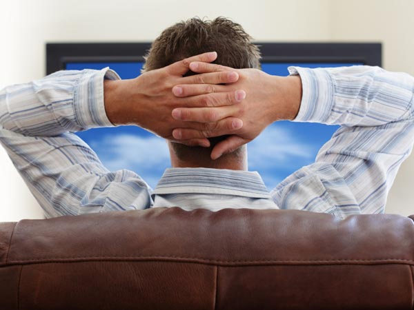 Man relaxed watching TV.