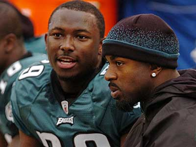 Brian Westbrook (right), seen here with Eagles rookie running back LeSean McCoy, missed Sunday's Giants game due to a concussion. (Clem Murray / Staff Photographer)