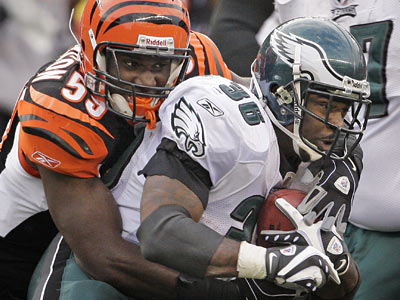Eagles Brian Westbrook was brought down by Bengals Brandon Johnson last weekend for a three yard loss in the OT quarter. (Ron Cortes/Staff Photographer)