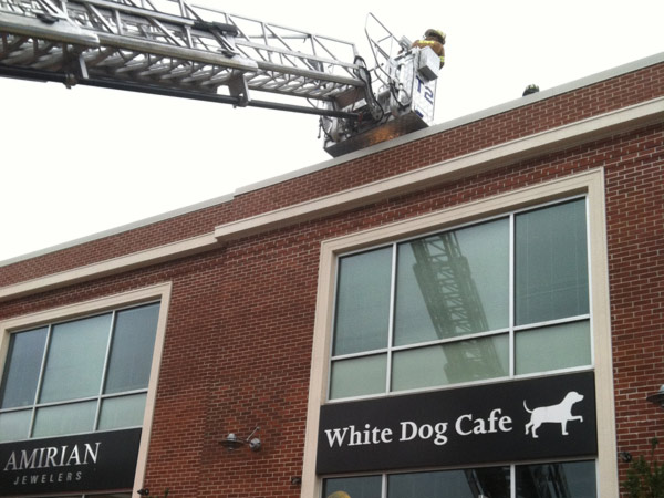 Firefighters battle a fire inside the White Dog Cafe in Wayne, Delaware County, Thursday, Aug. 1, 2013. (Mari Schaefer / Staff)