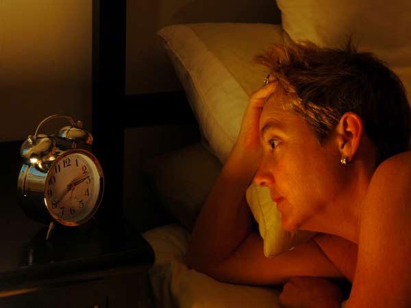 Woman wide awake at night.