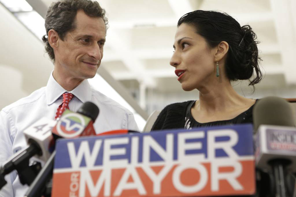 FILE - In this July 23, 2013 file photo, Huma Abedin, alongside her husband, then-New York mayoral candidate Anthony Weiner, speaks during a news conference in New York. Democratic presidential candidate Hillary Clinton aide Huma Abedin says she is separating from husband Anthony Weiner after another sexting revelation involving the former congressman from New York.