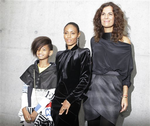 American actress and singer Jada Pinkett Smith poses with her daughter Willow Smith and Roberta Armani, right, after attending the presentation of the Emporio Armani Spring-Summer 2011 fashion collection, during the fashion week in Milan, Italy, Saturday, Sept. 25, 2010. (AP Photo/Luca Bruno)
