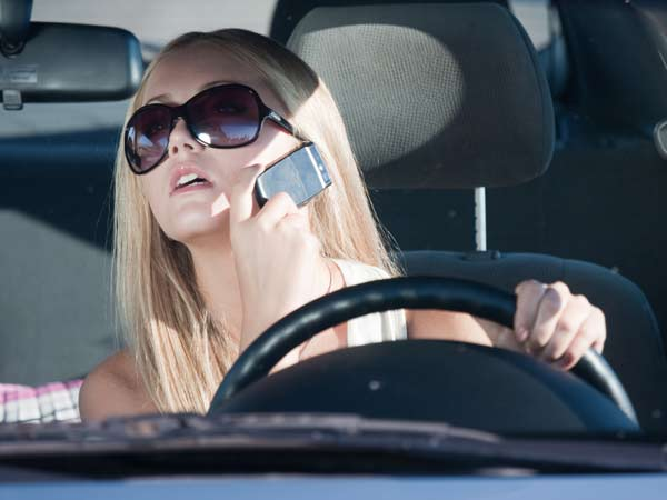 Up to half of teens talking on cellphones while driving are speaking with their mother or father, according to new research.