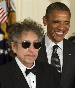 President Barack Obama smiles as he awards the Medal of Freedom to rock legend Bob Dylan, Tuesday, May 29, 2012, in the East Room of the White House in Washington. (AP Photo/Carolyn Kaster)