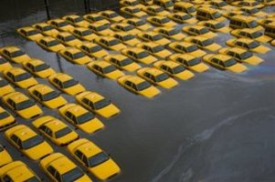Yellow cabs in Hoboken, N.J., on Tuesday.  (AP Photo/Charles Sykes)