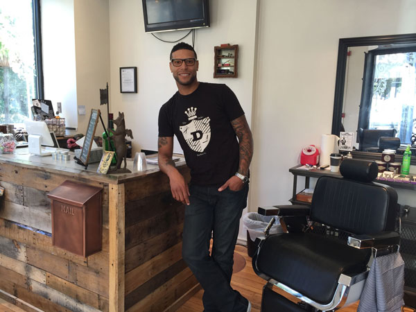 Walter Brown is the owner of The Duke Barber Co. He is shown in his newly-opened second barber shop in Chestnut Hill. (Michael Hinkelman / Daily News Staff)