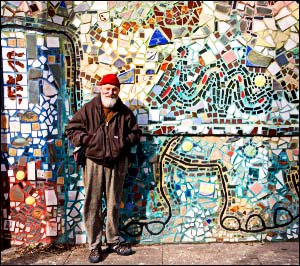 Zagar by one of his walls in a photo from his Web site by Gabe Kirchheimer.