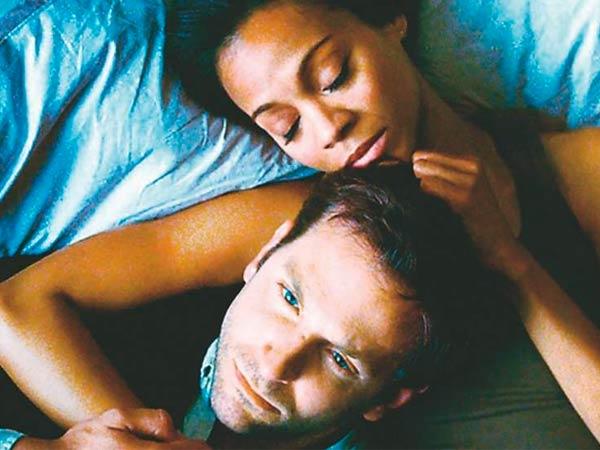 "Zoe Saldana (right) portrays the girlfriend of Bradley Cooper in ""The Words."""