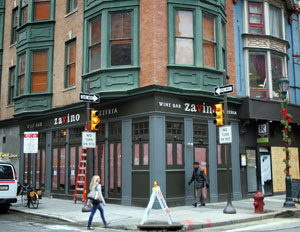 Zavino at 13th and Sansom. At right, beneath plywood is the planned Barbuzzo from the team who own Lolita, Bindi, et al.