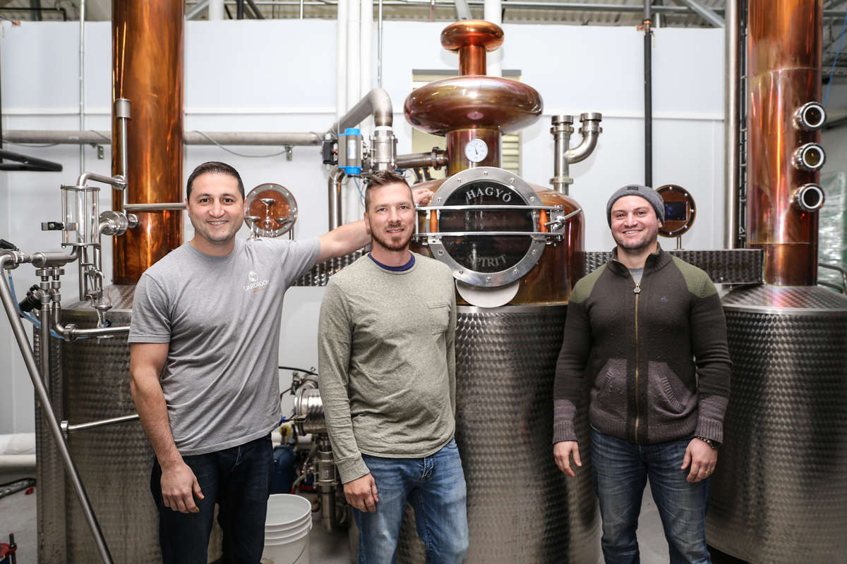 Owner Vlad Mamedov (left), Distiller Tim Mokes (center) and Owner Marat Mamedov (right), with the stills that were customized for them from Hungary, at Boardroom Spirits. (TONI FARINA / Staff Photographer)