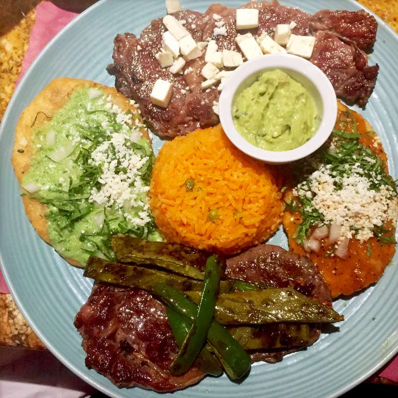 Tlacoyos and rib eye steaks from El Mariachi Loco. (CRAIG LABAN / Staff)
