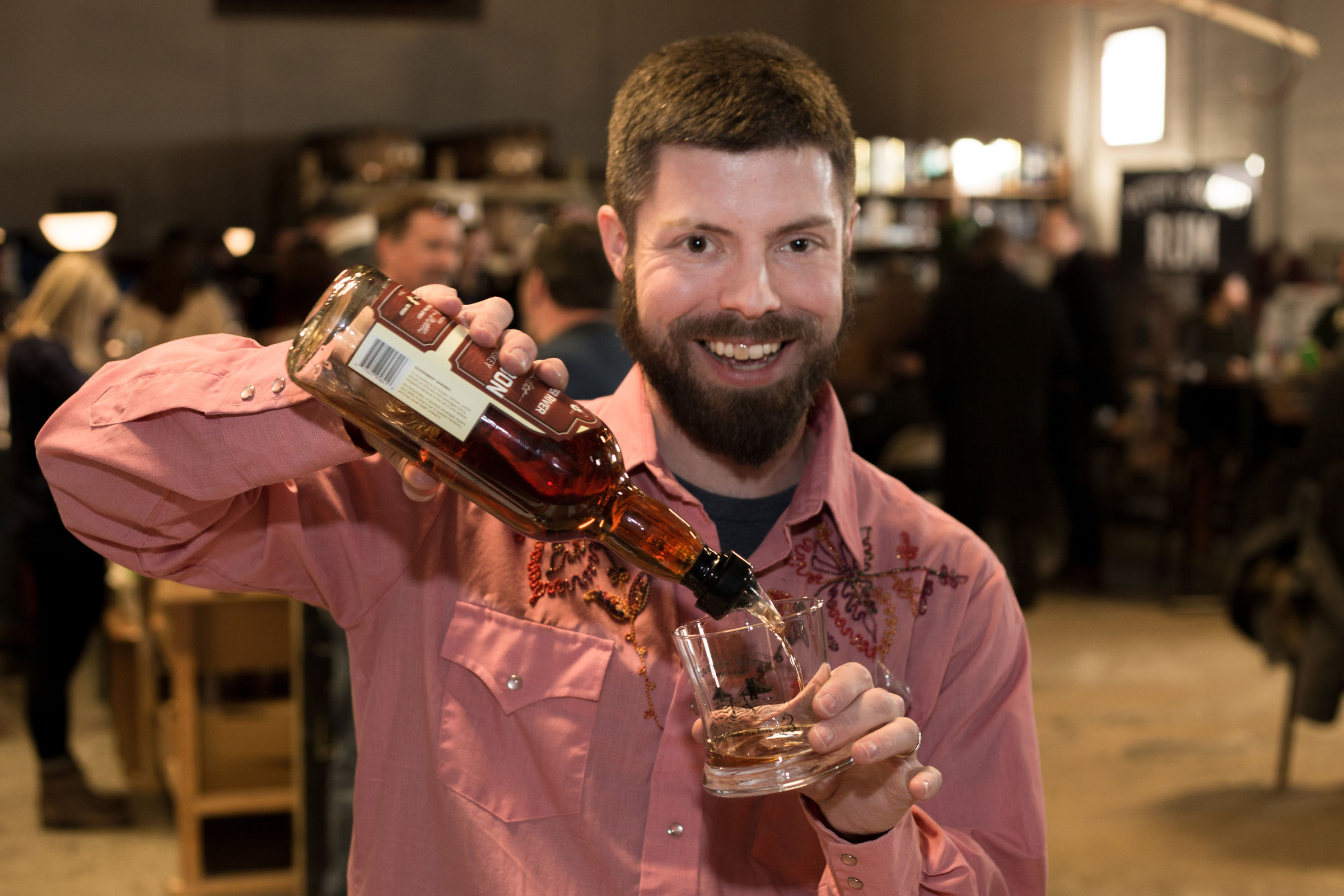 Cooper River Distillers' Chief Distiller James Yoakum pouring a sample of Cooper River Bourbon at their Bourbon Release Party. ()
