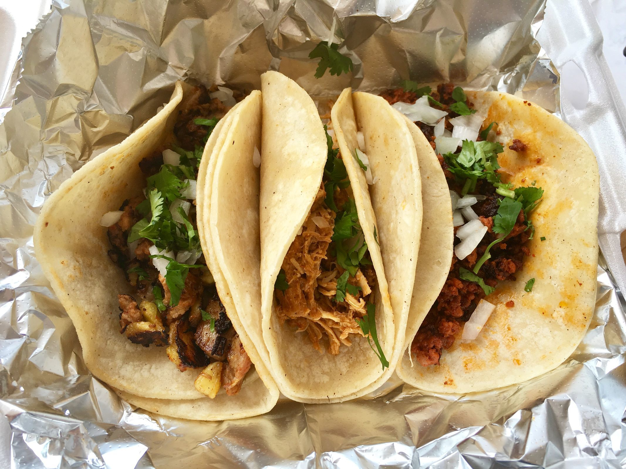 Tacos (al pastor, chicken tinga, and chorizo) at Tlaxkalli, 348 W. Gay St., West Chester. (MICHAEL KLEIN / Staff)