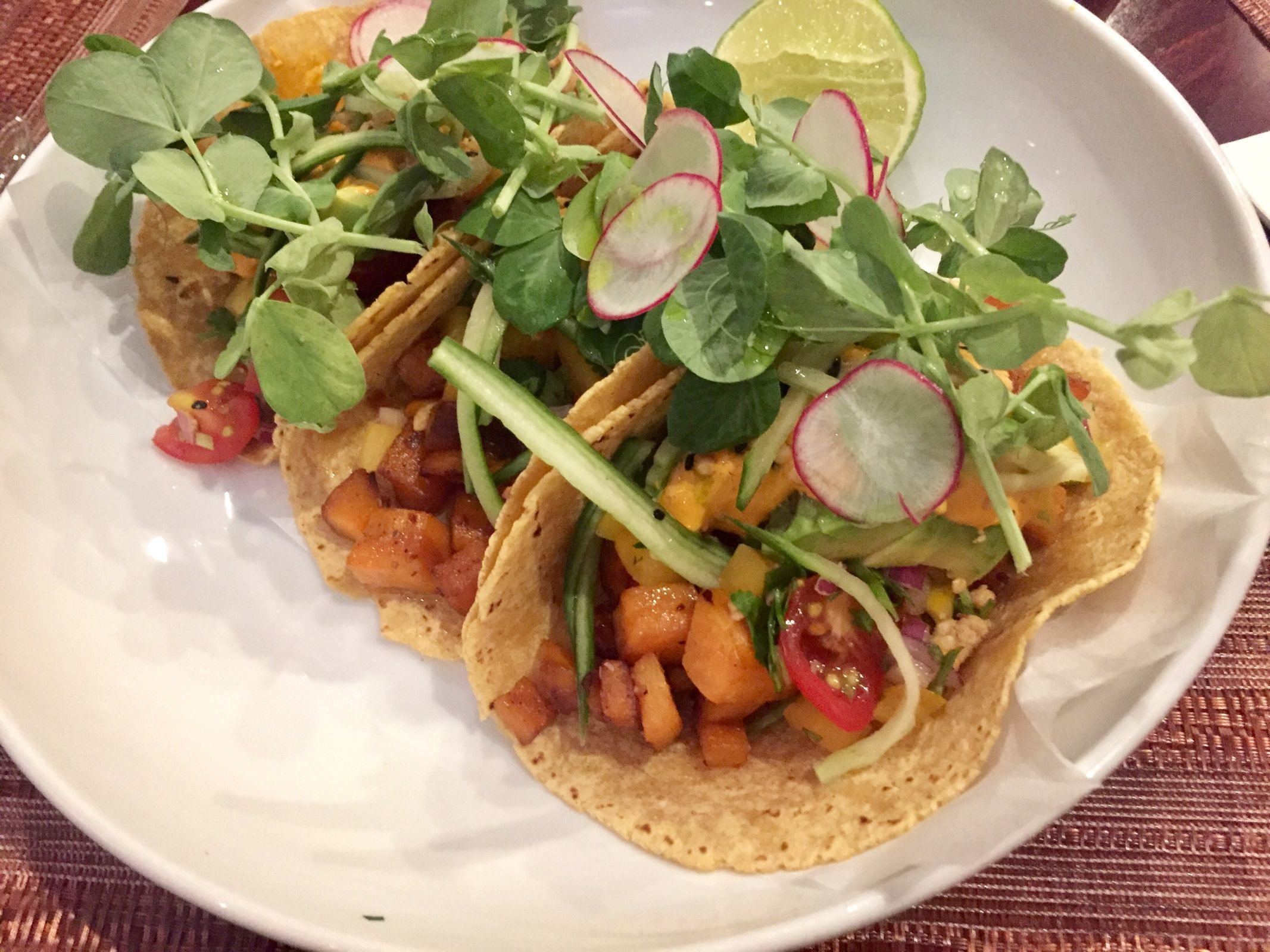 Buddha tacos with sweet potato hash, chile crema, peanuts, pico de gallo and greens from Blue Sage Vegetarian Grille in Southampton. (CRAIG LABAN / Staff)