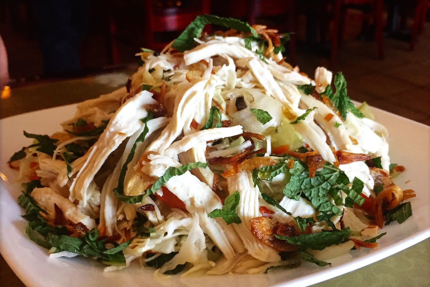 The citrusy goi ga chicken and cabbage salad with mint at Pho & Beyond in Willow Grove. (CRAIG LABAN / Staff)