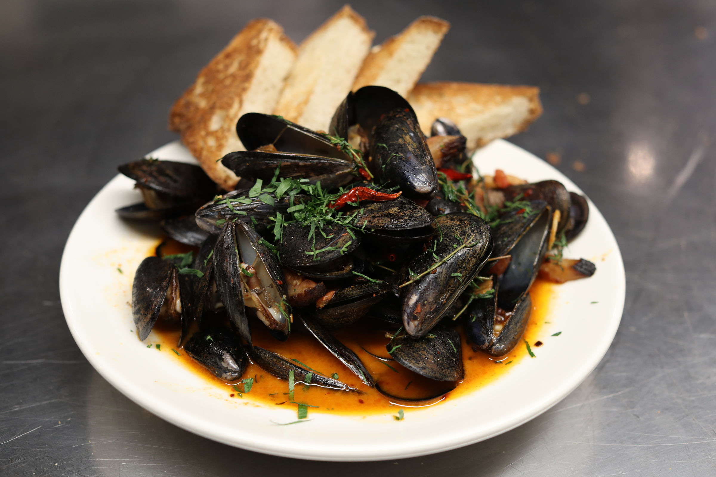 The spicy mussels at Henry's Cafe & Fine Groceries.