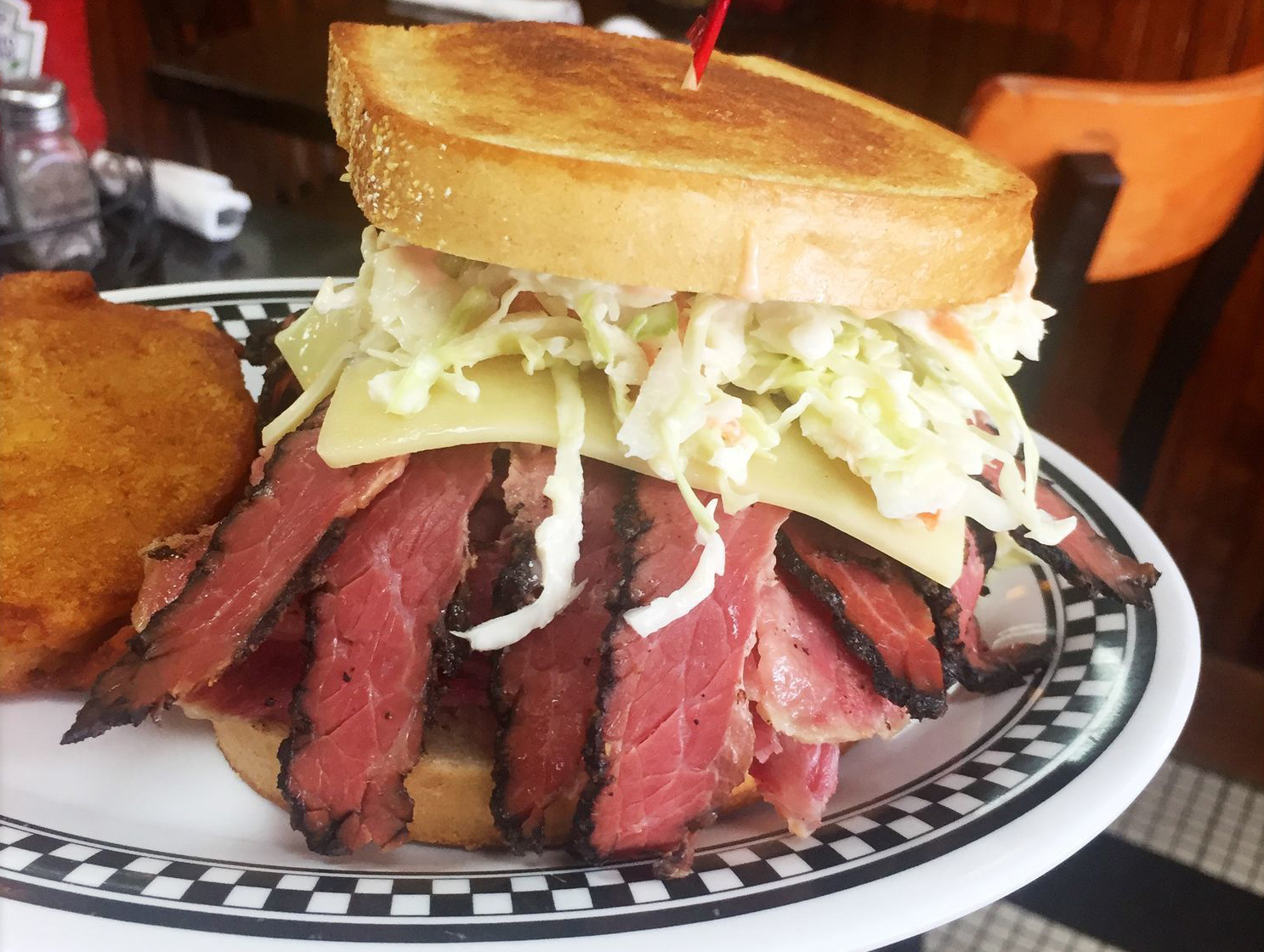 The corned beef and pastrami combo with Swiss cheese and cole slaw at the Kibitz Room in Cherry Hill. (CRAIG LABAN / Staff)