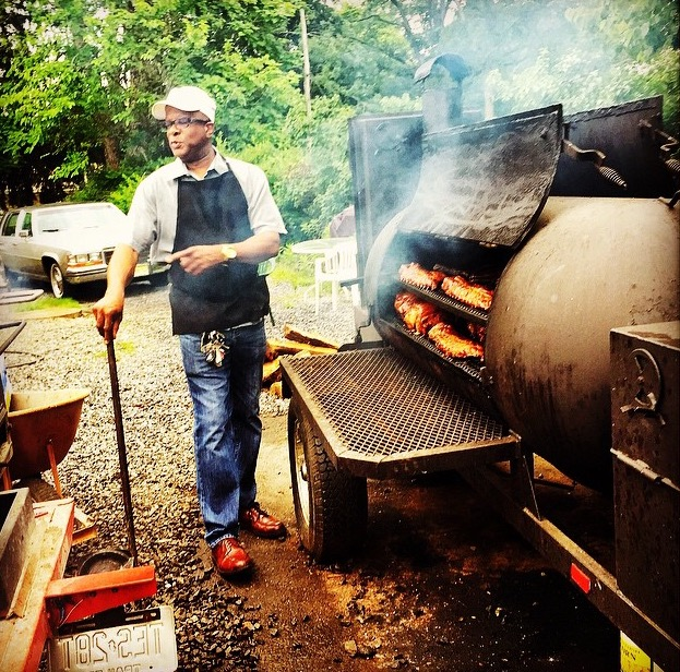 Doug Henri tends the smoker pit at Henri's Hotts Barbeque in Hammonton. (CRAIG LABAN / Staff)