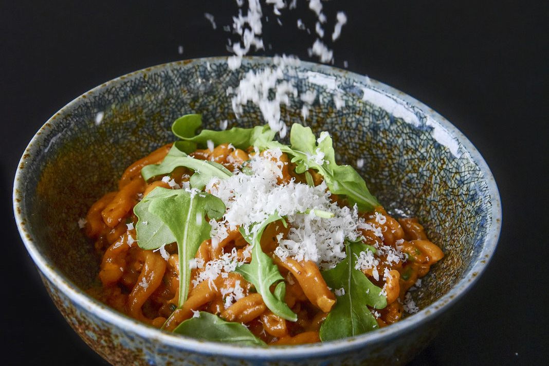 The gochujang gemelli with bacon bolognese, arugula, and parmigiano-reggiane grated on top at Charcoal BYOB. (CLEM MURRAY / Staff Photographer)