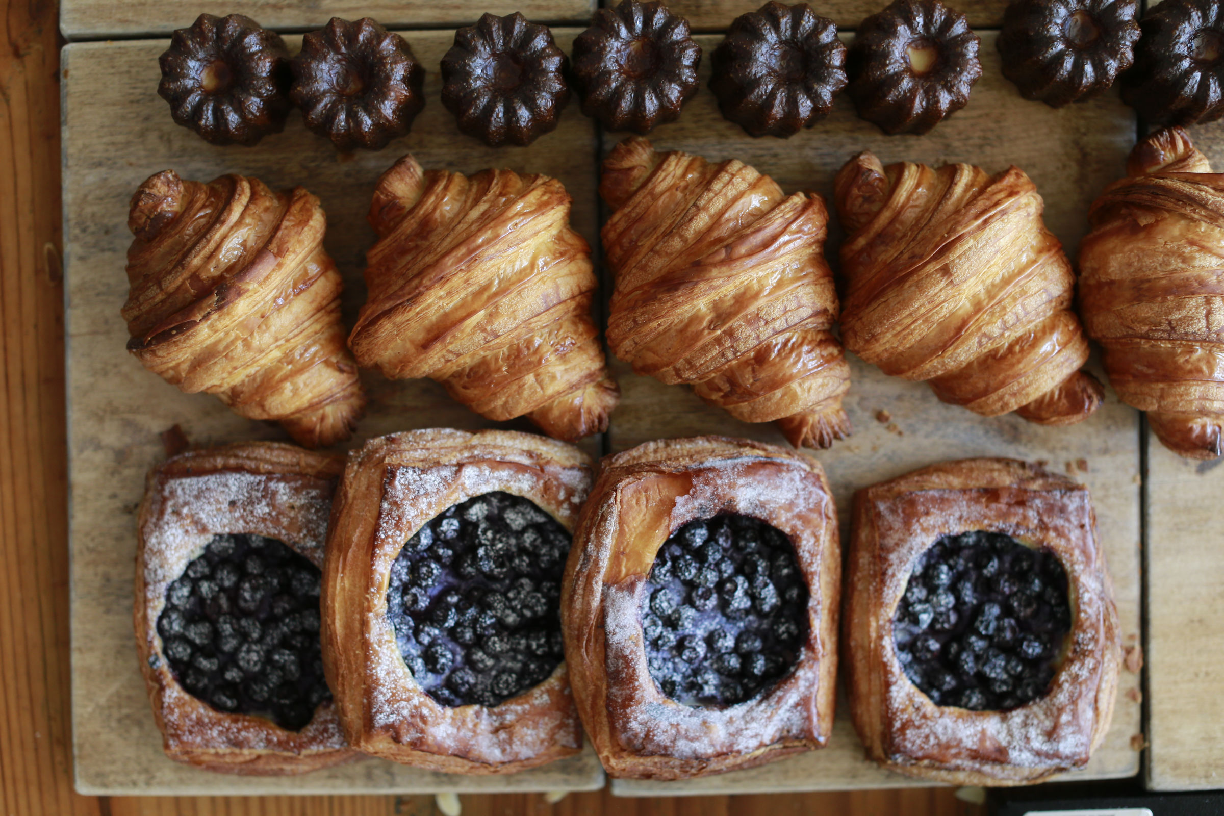 Vanilla bean canele, croissant and the local blueberry tart with vanilla cream at Malvern Buttery.