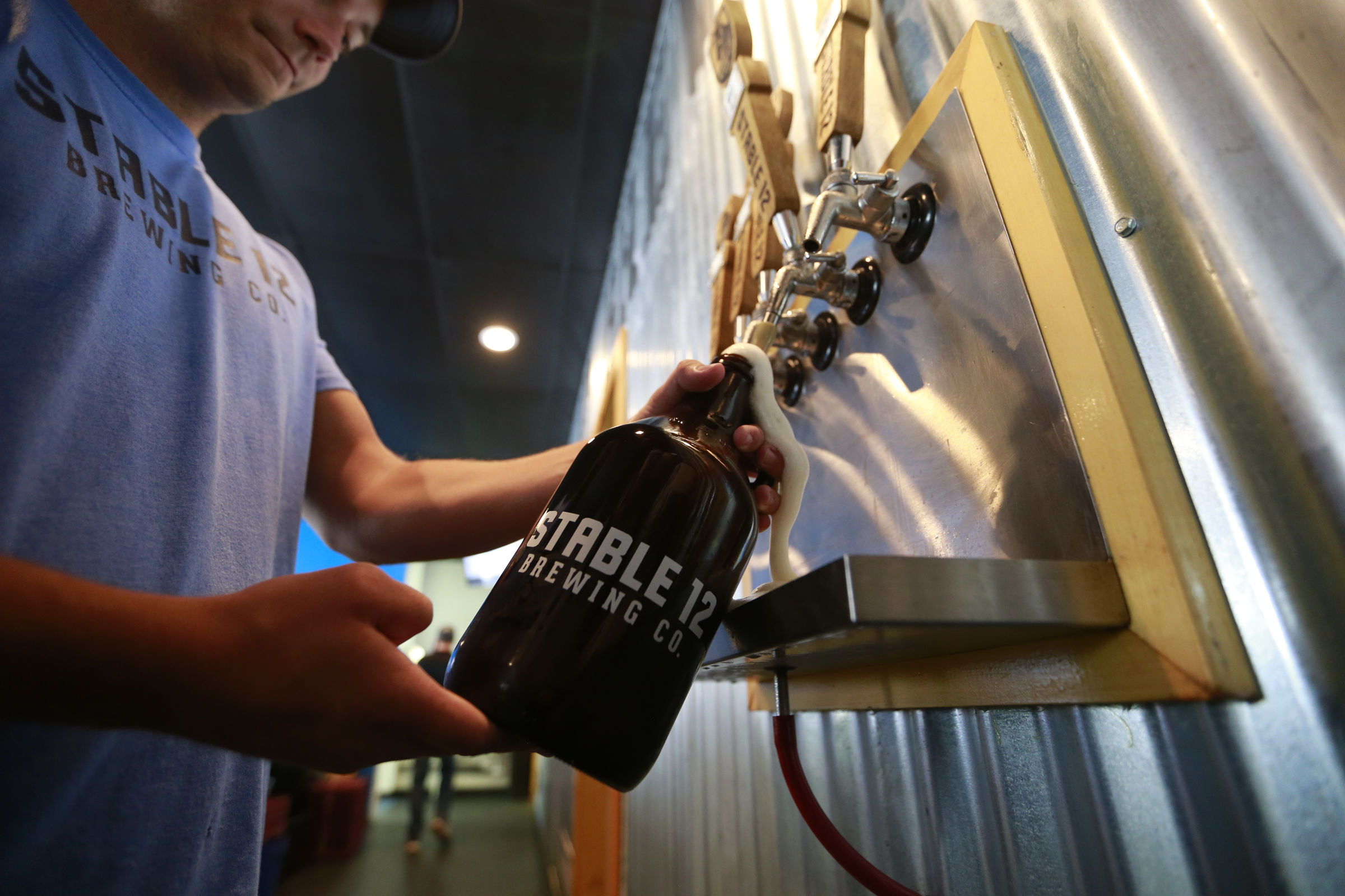 A growler is poured at Stable 12 in Phoenixville.