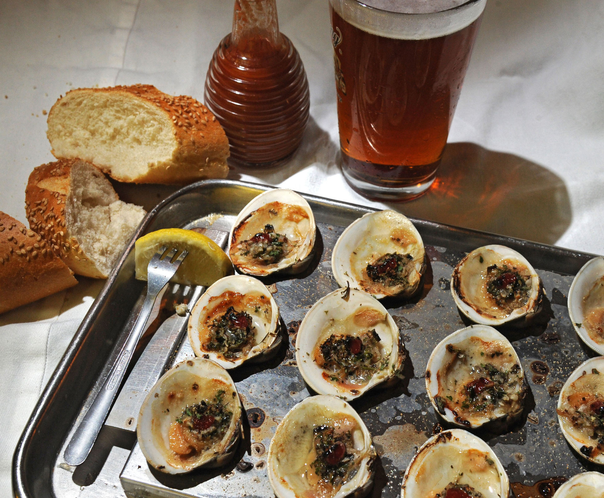 The house broiled clams from The Clam Tavern. (CLEM MURRAY / Staff Photographer)