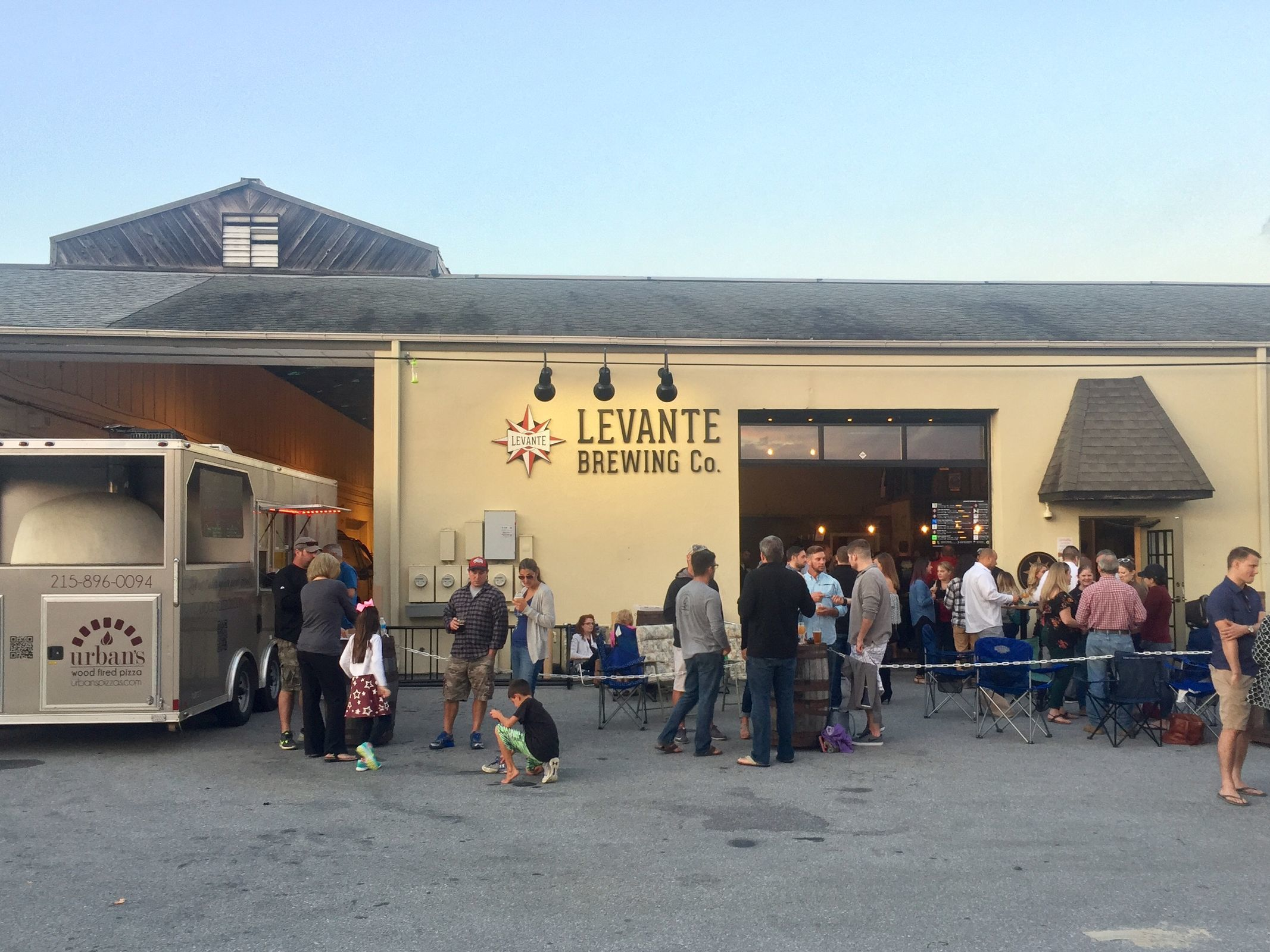 A crowd finds Levante Brewing in the back of a West Chester industrial park for evening hours and food trucks. (CRAIG LABAN / Staff)