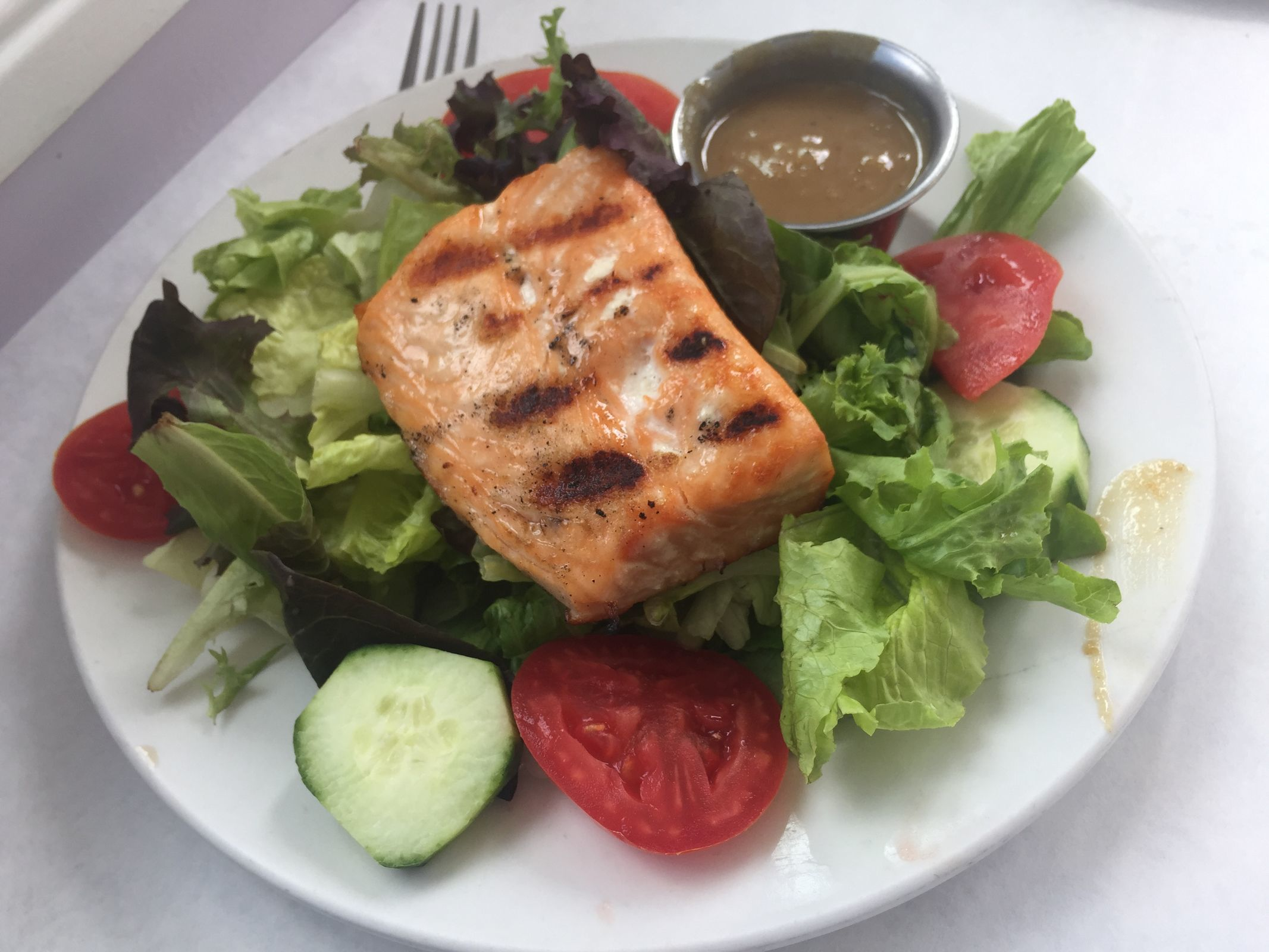 Thai salmon salad at Zakes Cakes and Cafe in Fort Washington. (CRAIG LABAN/Staff)