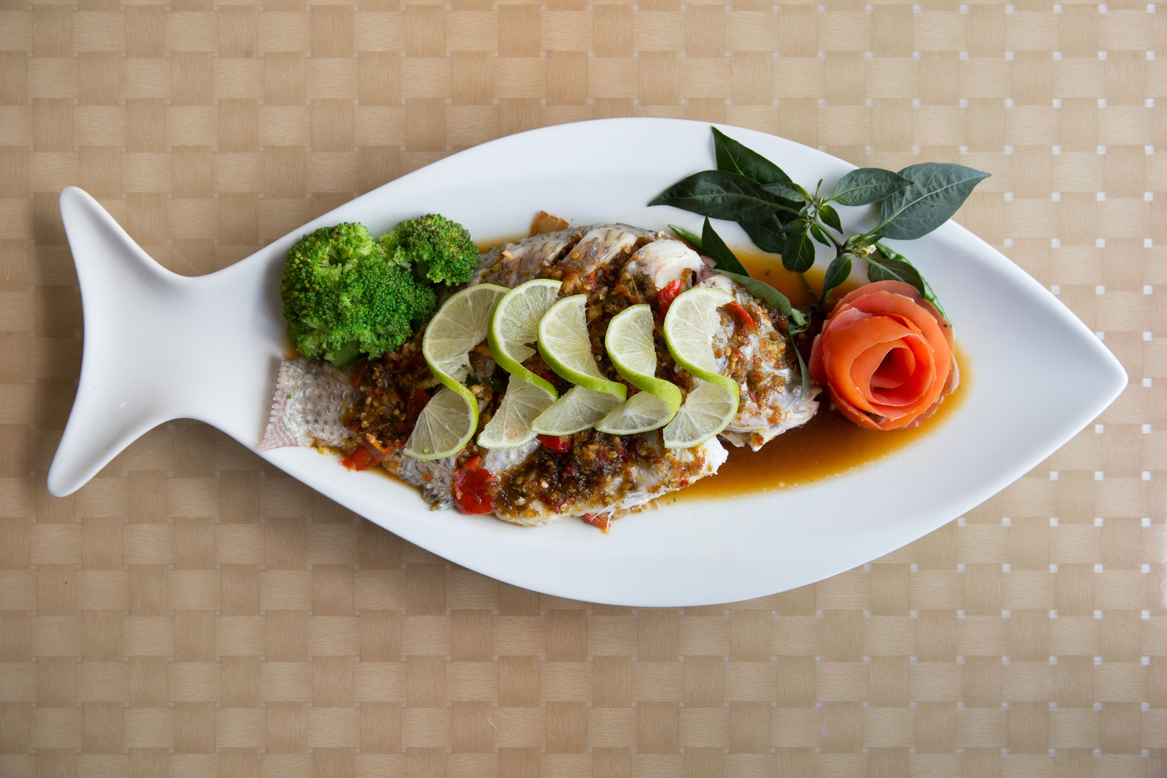 Steamed whole fish with spicy lime sauce at Sa-bai-dee, 7038 Terminal Square, in Upper Darby. (JESSICA GRIFFIN / Staff Photographer)