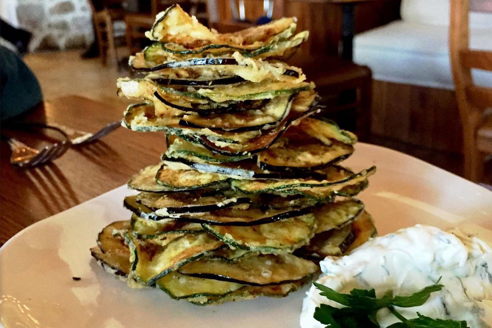 Estia chips brings a towering stack fried zucchini and eggplant rounds. (CRAIG LABAN / Staff)