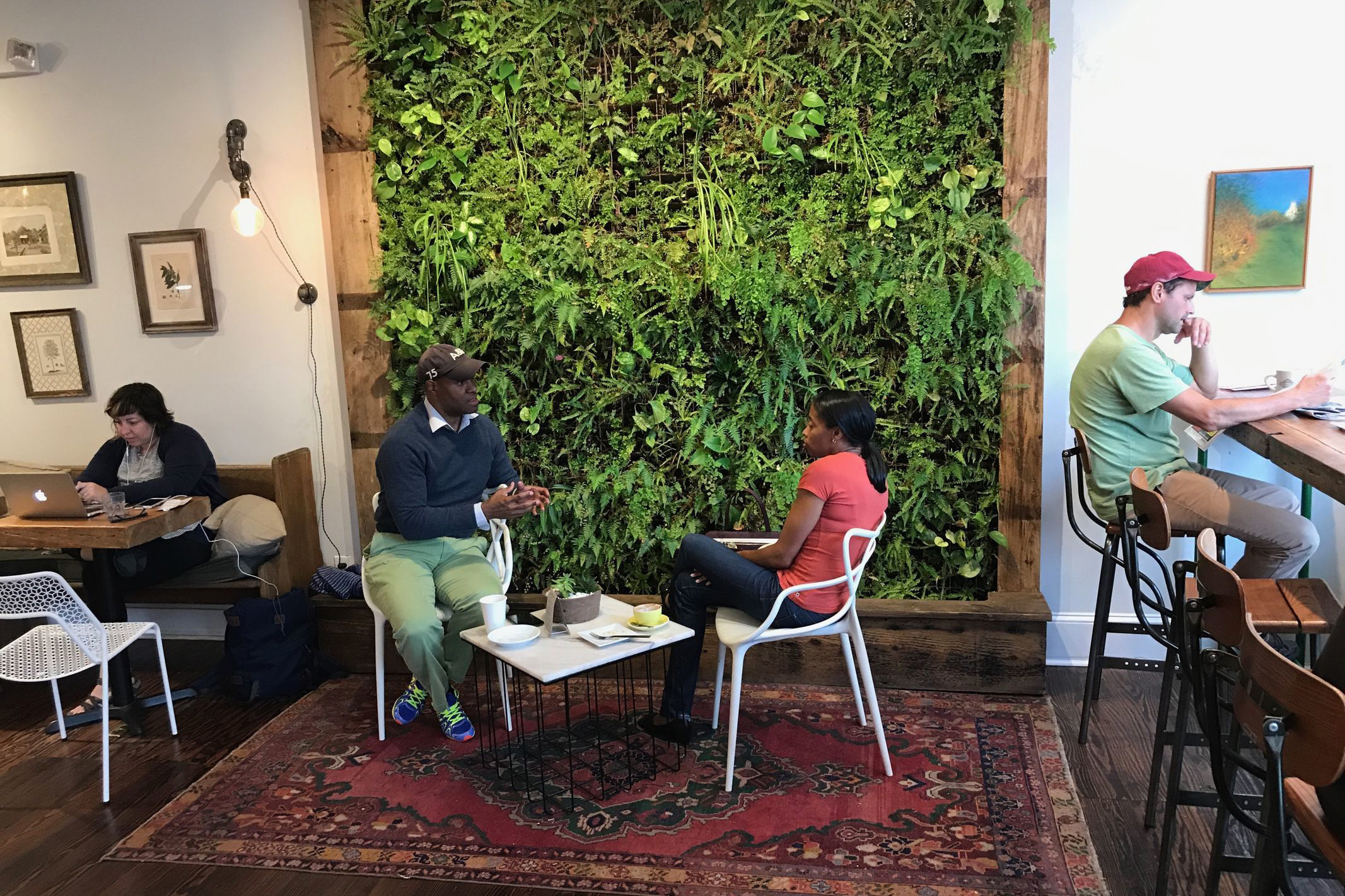 The live plant wall is a signature design feature at Green Engine Coffee Co. (CRAIG LABAN / Staff)