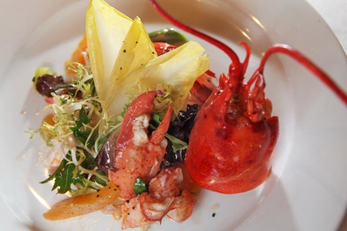 Lobster and asparagus salad with fresh lemon, olive and lobster oils, red onion and Belgium endive at The Pelican Restaurant. (DAVID M WARREN / Staff photographer)