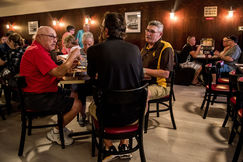 Max Putter (left), 77, and wife Carole dine with Karl Hornick (right), 65, and Scott Luckenbihl, 46. The Putters now live in Ventnor, but they're from Philadelphia. He coached the Philadelphia Comets, in Delaware Valley Jr. hockey league, at Grundy Rink in Bristol. Karl Hornick, 65, was the team's captain from 1972-74. Hornick now lives in Douglas, Wyo., and coaches hockey squirts himself. When he came to town with a convention and went to visit his old coach, Putter took him to his favorite place — Tony's Baltimore Grill.