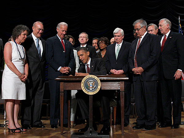 President Obama signs Dodd-Frank in 2010. PABLO MARTINEZ MONSIVAIS / Associated Press